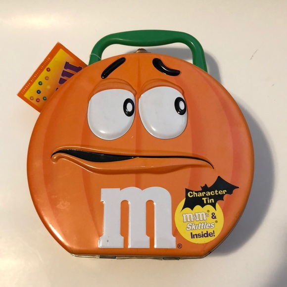 M&ms character tin. 2002 does not include candy.
